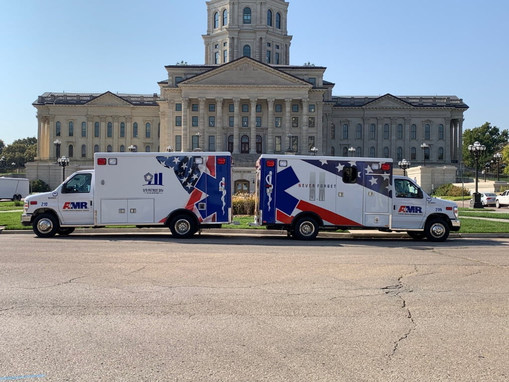 The photo shows two ambulances facing away from each other.