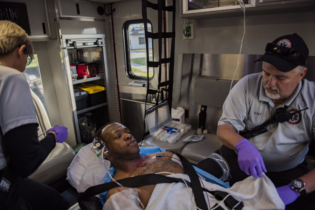 A patient in the back of an ambulance during a training drill.