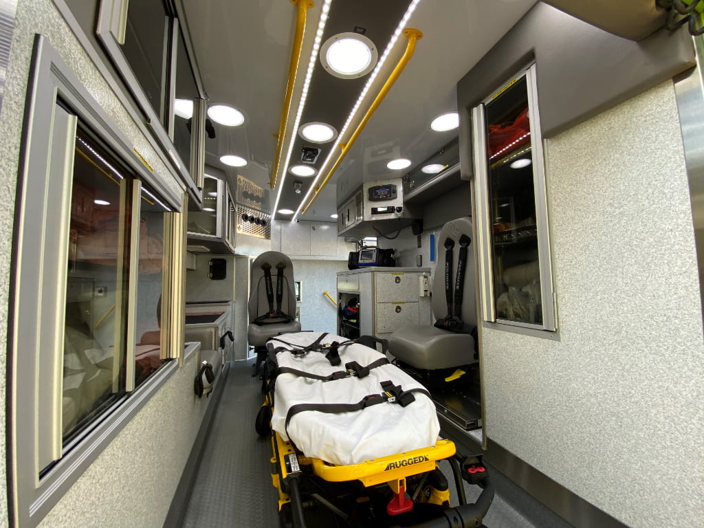 The new Lexington County EMS rigs have a Stryker Power-LOAD cot in the center of the patient module, and IMMI Per4Max four point harness systems on all the seating.