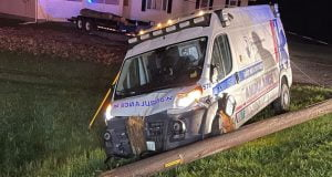 An East Millinocket Ambulance is shown with damage to the hood after slamming into a utility pole.