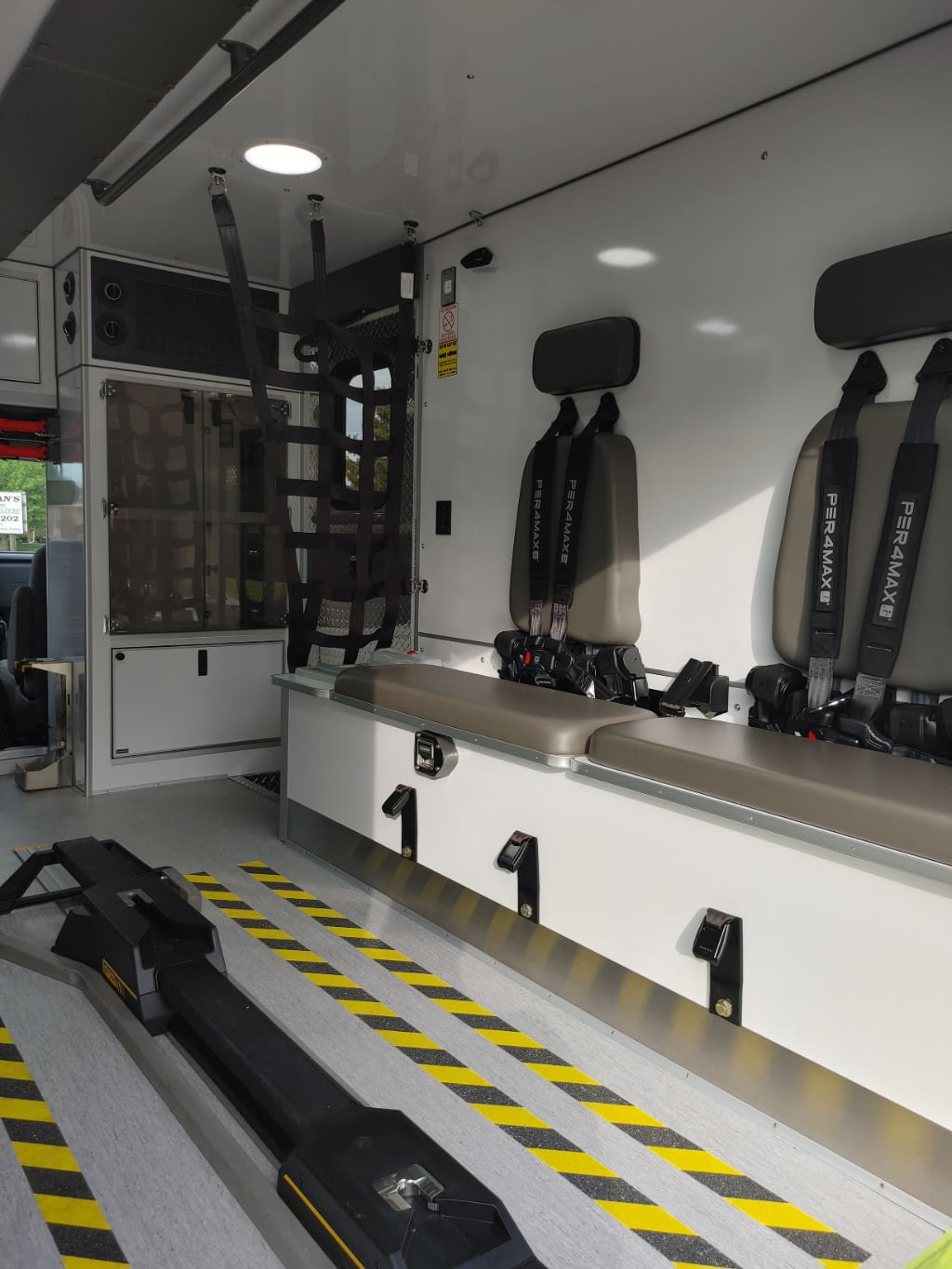 The squad bench in the AEV-built ambulance has two seating positions, each protected by a Per4Max four point harness system.