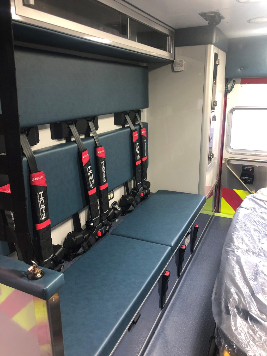 The squad bench area on the new Horton ambulance for North Andover. The ambulance has the Horton Occupant Protection System, which includes Per4Max four-point harness on all seating positions.