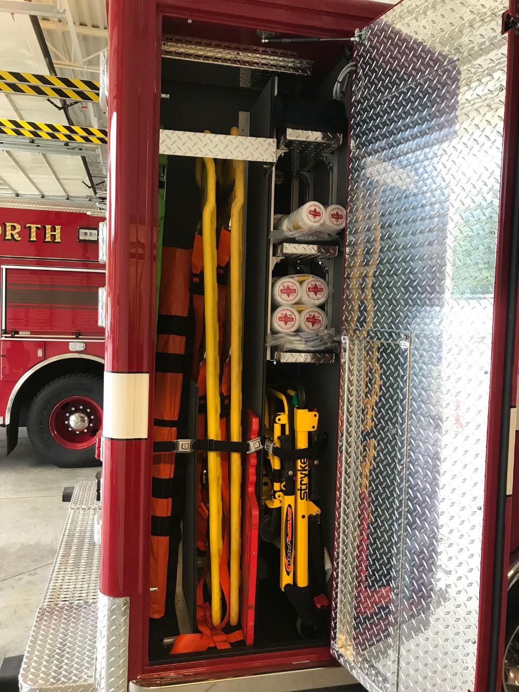 The exterior rear officer's side compartment holds backboards, folding stretchers, a stair chair and other gear.